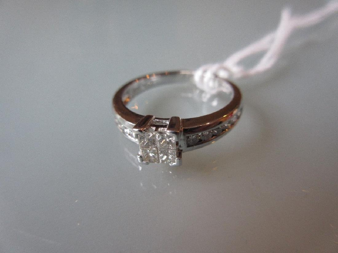 18ct White gold ring set princess and brilliant cut