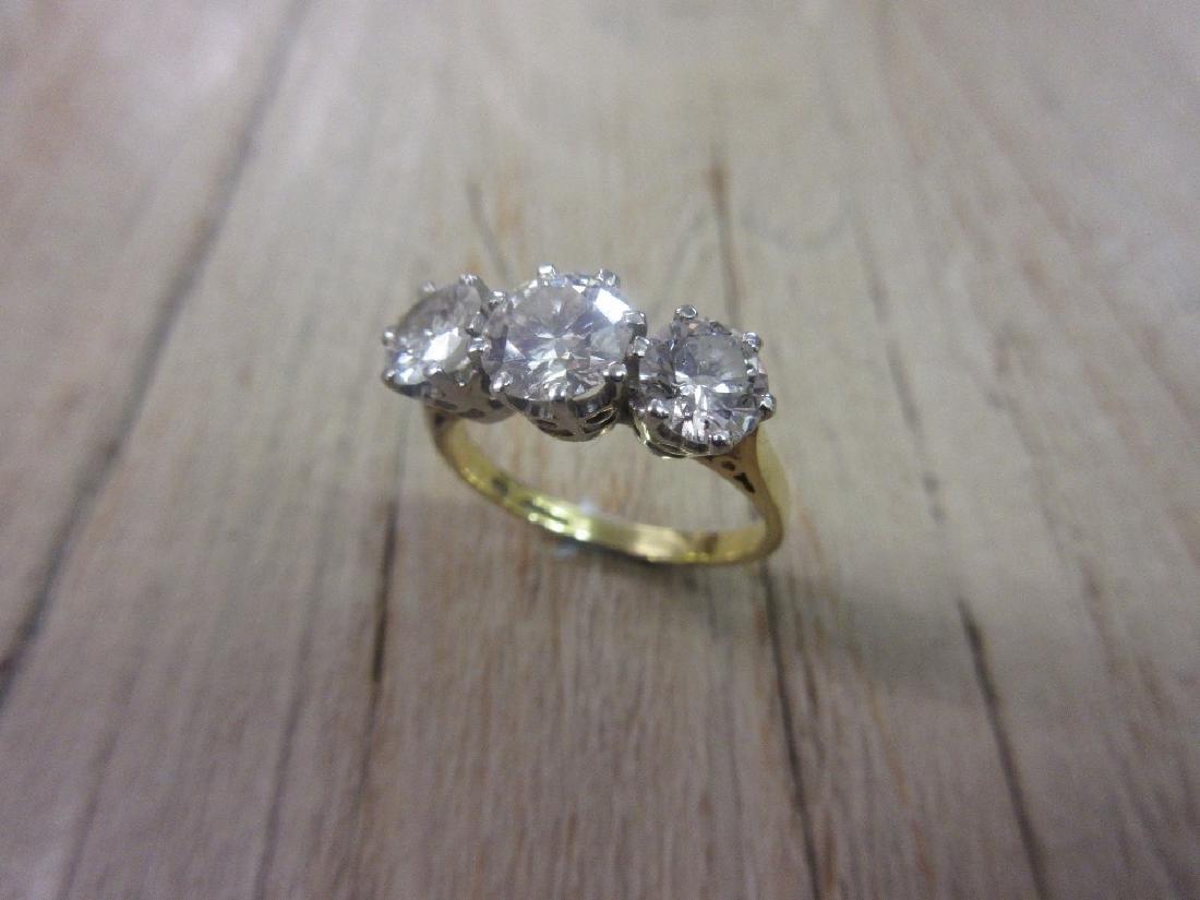 18ct Yellow gold three stone brilliant cut diamond