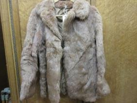 Ladies pale brown fur jacket together with a goat skin