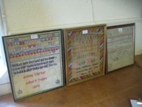 Group of three wool and needlework alphabet samplers