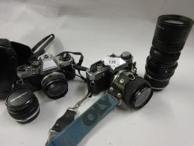 Two Olympus S.L.R. cameras OM10 and OM20 together with