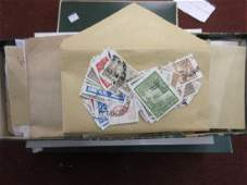 Three boxes containing collections of World stamps