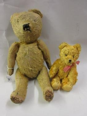 Straw stuffed jointed teddy bear together with a