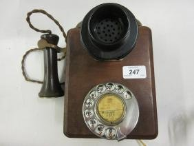 Early 20th Century wooden wall telephone