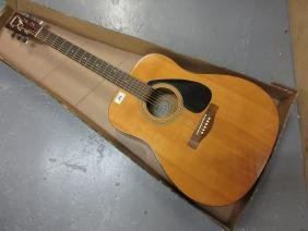 Yamaha F310 acoustic guitar fitted with electric