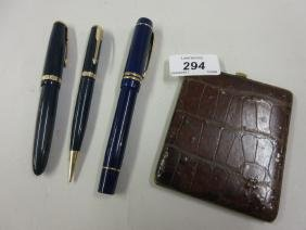 Two Parker fountain pens with screw covers, a Parker