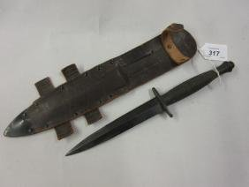 World War II Commando knife in leather sheath