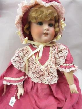 Schoenau and Hoffmeister bisque headed doll with