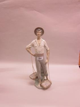 Lladro porcelain figure of a fisherman with baskets