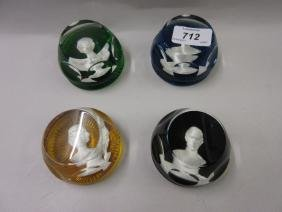 Group of four Baccarat paperweights by John Pinches,