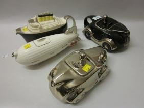 Four reproduction teapots in the form of motor cars, an