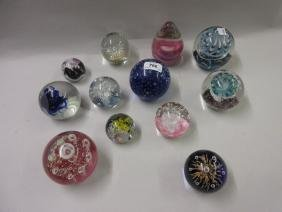 Collection of twelve various glass paperweights