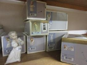 Group of seven various boxed Lladro figures