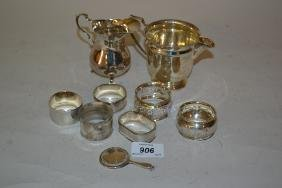 Two silver cream jugs, five silver napkin rings, plated
