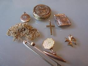 Gold bar brooch, two small chains, three lockets, a