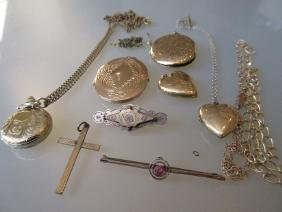 Two 9ct gold oval pendant lockets with chains, together