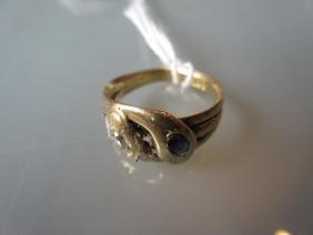 Yellow gold serpent ring set sapphire and diamond