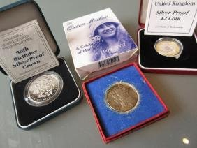 Three cased silver proof coins together with a boxed