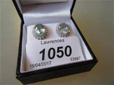 Pair of 18ct white gold aquamarine and diamond cluster