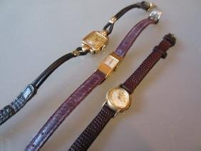Three various ladies gold cased wristwatches with