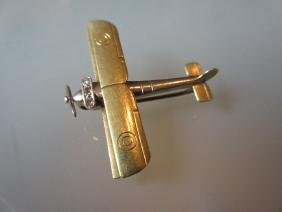 15ct Gold diamond set brooch in the form of a bi-plane
