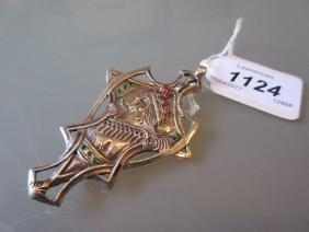 Silver Art Nouveau pendant / brooch, profile of a lady