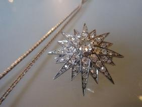 White gold diamond star pendant brooch on an 18ct white
