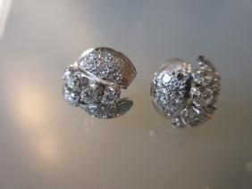 Pair of platinum circular diamond cluster earrings,