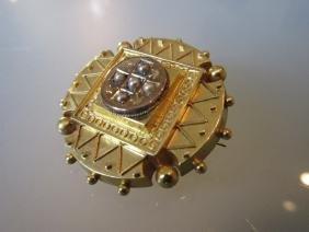 Victorian circular gold brooch set seed pearls