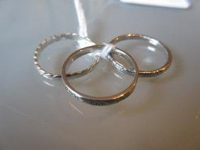 Platinum wedding band, silver wedding band and another