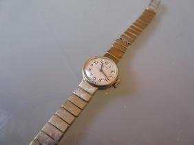 Ladies Movado 9ct gold wristwatch with integral
