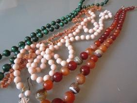 Pale coral bead necklace, an agate necklace, malachite