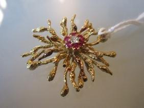 Yellow gold brooch set diamonds and six rubies