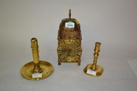 Small brass lantern clock with quartz movement and two