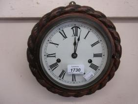 Circular carved oak rope pattern wall clock, the enamel