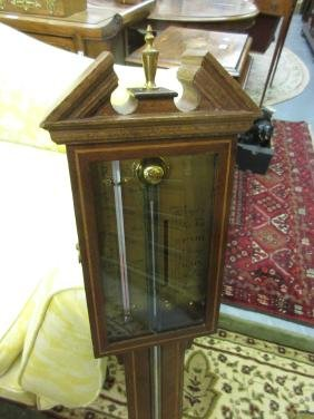 Reproduction mahogany and line inlaid stick barometer
