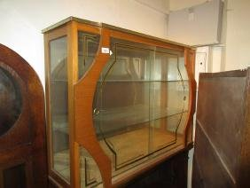 1950's Display cabinet of stylised design with sliding