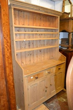 19th Century stripped pine dresser with a boarded shelf