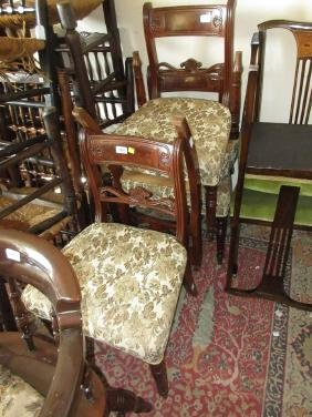 Set of four George IV mahogany rail back dining chairs