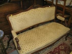 19th Century French carved walnut salon sofa, the