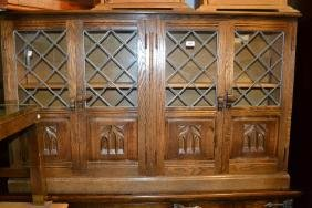 Reproduction oak dwarf four door bookcase with leaded