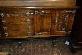 Reproduction oak dresser with boarded shelf back above