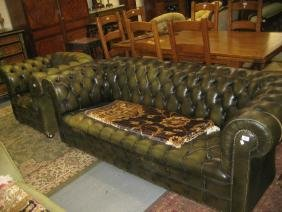 Green deep buttoned leather upholstered Chesterfield