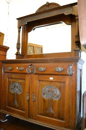 Art Nouveau walnut sideboard with a mirrored back above