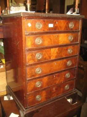 20th Century narrow mahogany chest with a reeded top