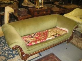 Victorian carved walnut and green upholstered sofa on