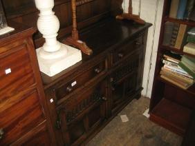 Reproduction oak dresser with a boarded shelf back