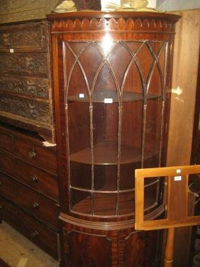 Reproduction mahogany bow fronted corner cabinet with a