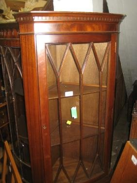 Reproduction mahogany standing corner cabinet