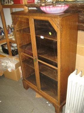 Small oak bookcase circa 1930 with two bevelled glass